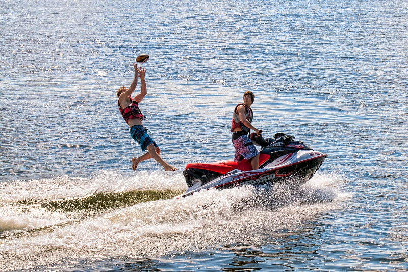 A little game of catch on the back of a jet ski photo