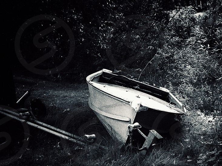Boat pond beached on land landed rowing boat  photo