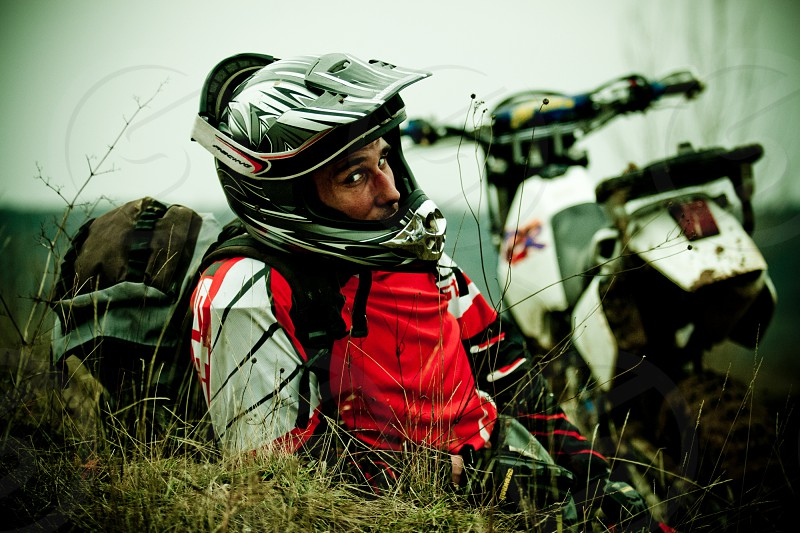 Enduro motocross rider traveller photo