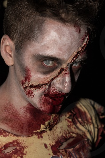 man with brown hair in yellow crew neck zombie costume photo
