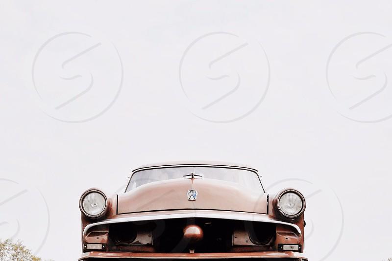 brown vintage sports car photo