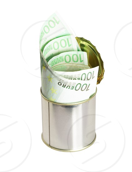 euro bills on a tin can over white background photo