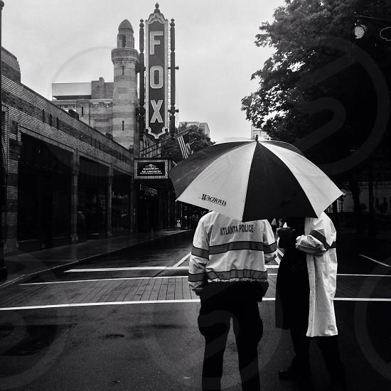 Atlanta Police stand guard on Peachtree Street for Atlanta Streets Alive on a rainy day. photo