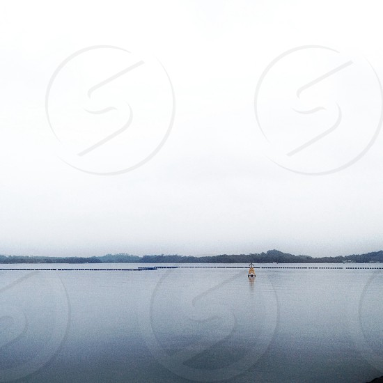 water front landscape with buoy photo