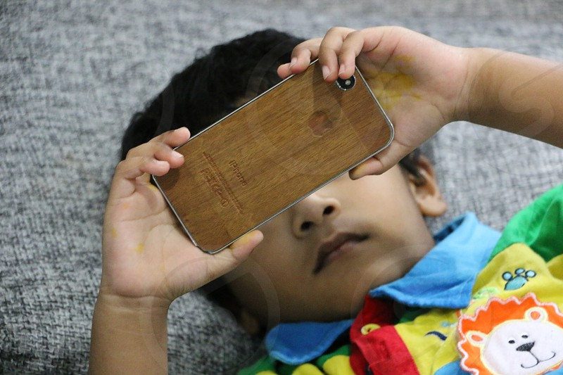 boy using an iphone photo