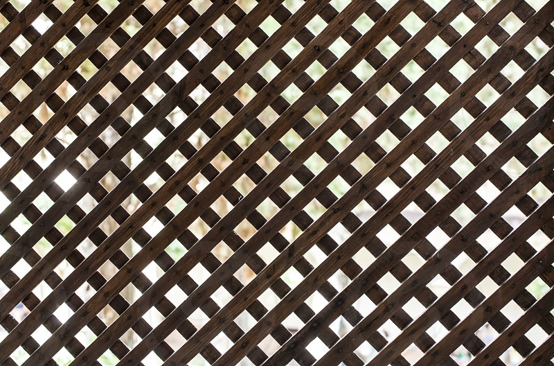 Latticed wooden partition. Back light photo