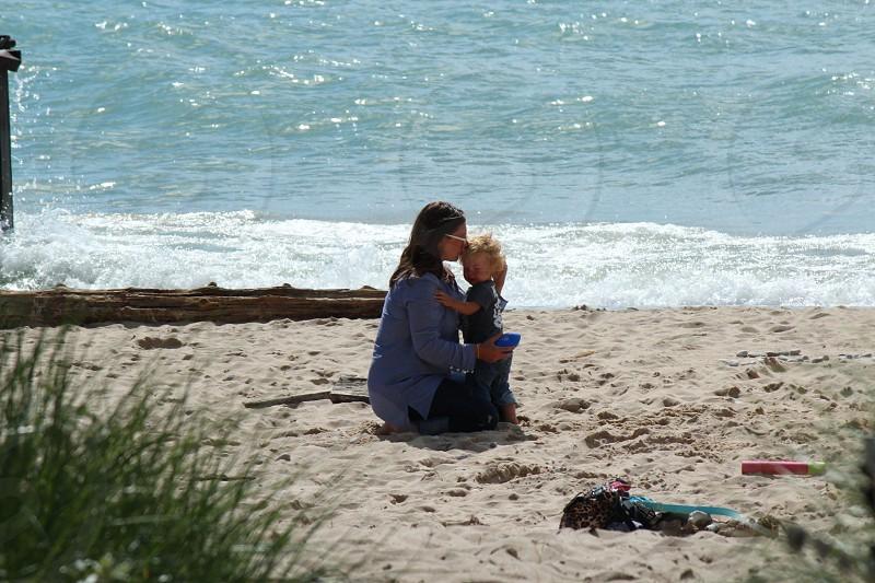 Mother son love beach families beach water  photo
