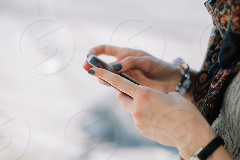 woman with green fingernails texting on  phone photo