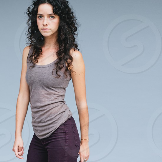 woman in gray tank top and purple denim jeans photo