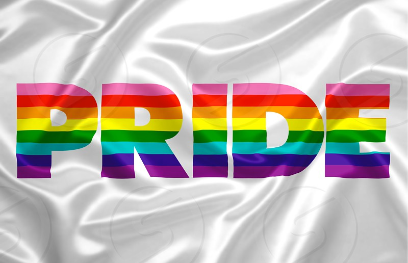 "the word ""pride"" composed with the colors of the rainbow printed on a silky fabric. photo"