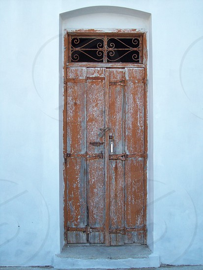 Door - weathered - neglected - entrance - opening - shabby - shabby chic - tatty - grand entrance - character - Greek - Greece - sun bleached - antique - grand entrance - what's beyond - flaky - peeling  - peeling paint photo