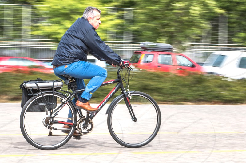 Middle Aged Man On Bike Ride In The City photo