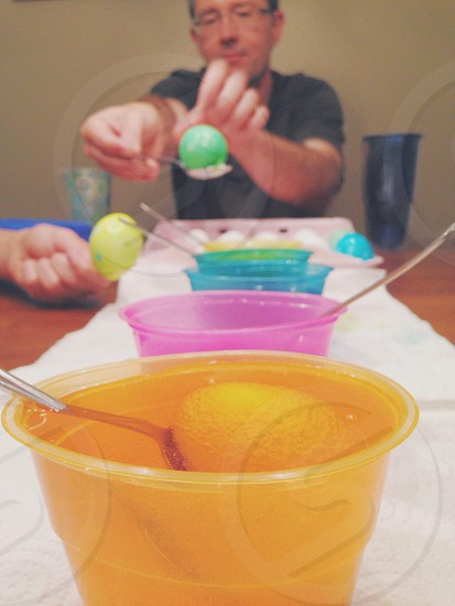 people scooping different color food photo