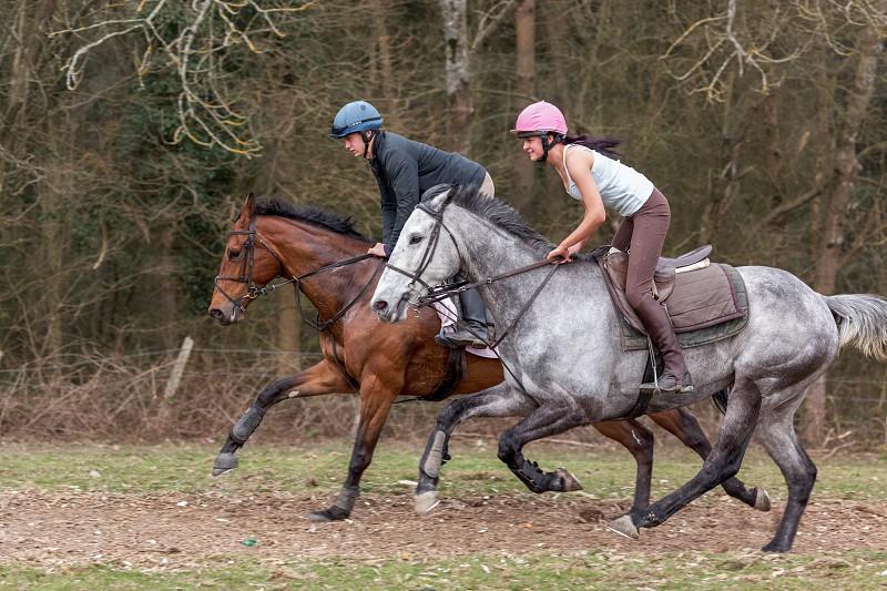 ASHURSTWOOD WEST SUSSEX/UK - MARCH 26 : Horse Riding near Ashurstwood West Sussex on March 26 2011. Two unidentified people photo