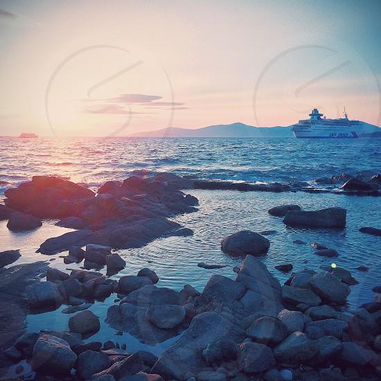 Sea ocean sunset Greece waves rocks   photo