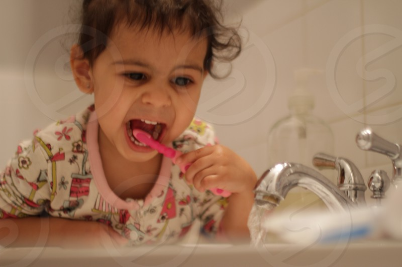 girl brushing her teeth photo