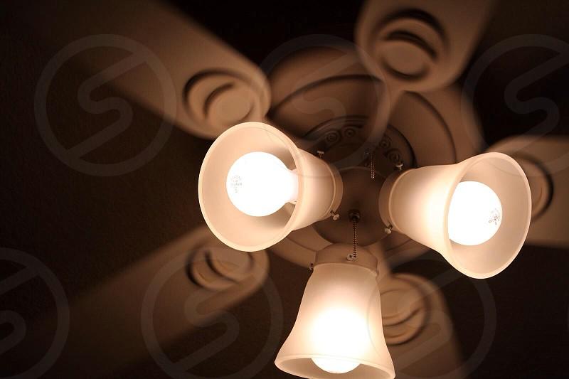 white 5 bladed ceiling fan with 3 light fixtures photo