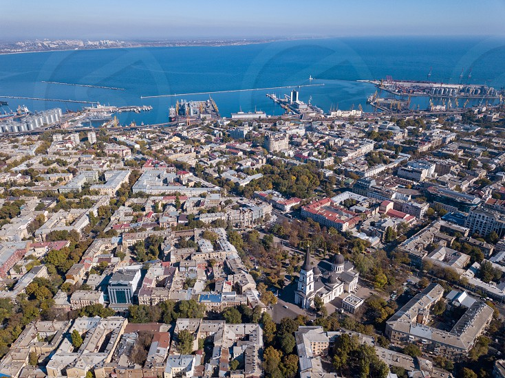 Panoramic view of the Black Sea with the port and the city from Spaso-Preobrazhensky Cathedral against the blue sky. Ukraine Odessa. Aerial view from the drone photo