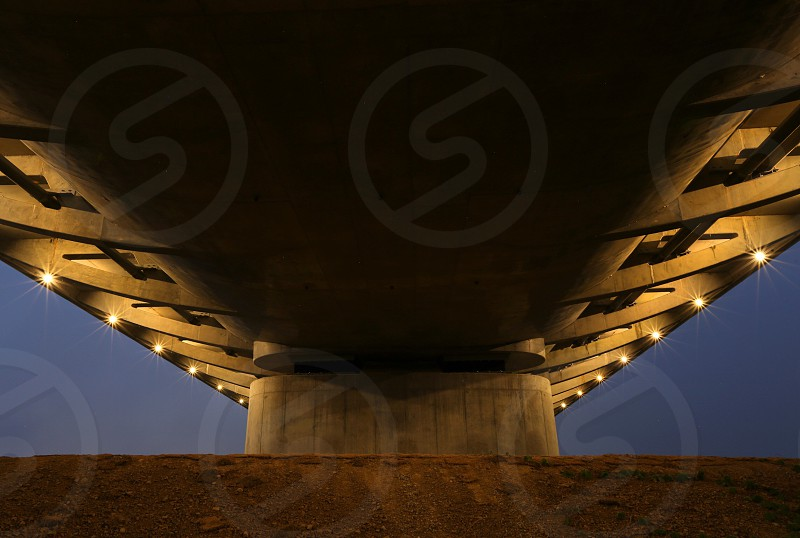 A bridge underside looks more like an approaching spaceship as night sets in  photo