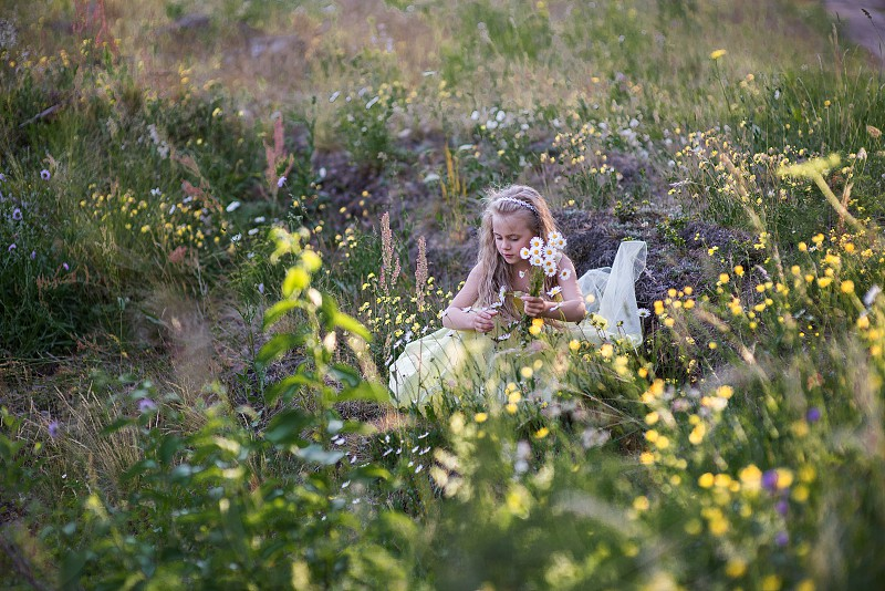 Little girl walking in the forest meadow photo