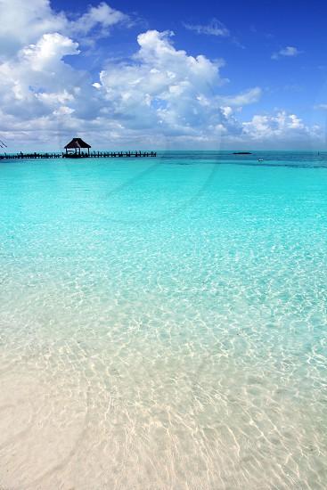 Caribbean tropical beach cabin pier Contoy island Mexico photo