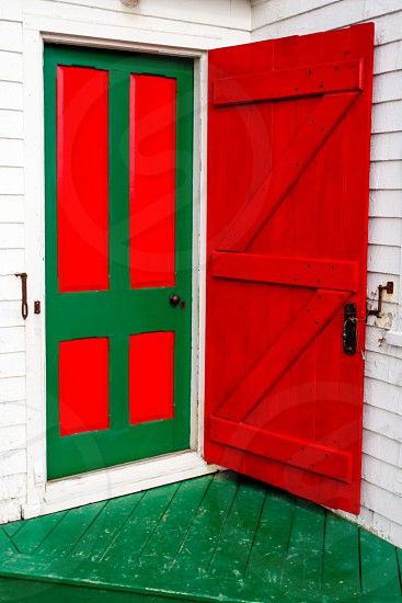 Colorful wooden entrance door of traditional frame building photo
