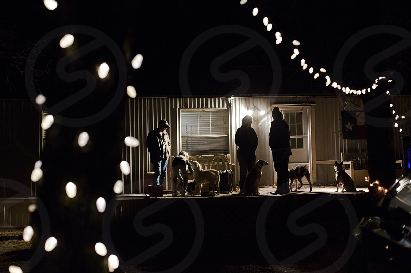 Friends and family hanging out on a trailer porch in Texas on Christmas. photo