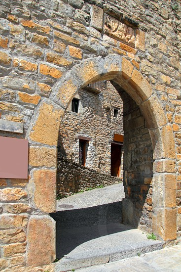 Ainsa medieval romanesque village arch fort door masonry Huesca Aragon Spain photo