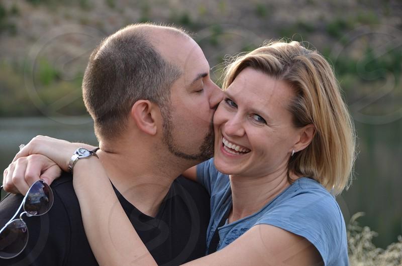 Man kissing woman smiling photo