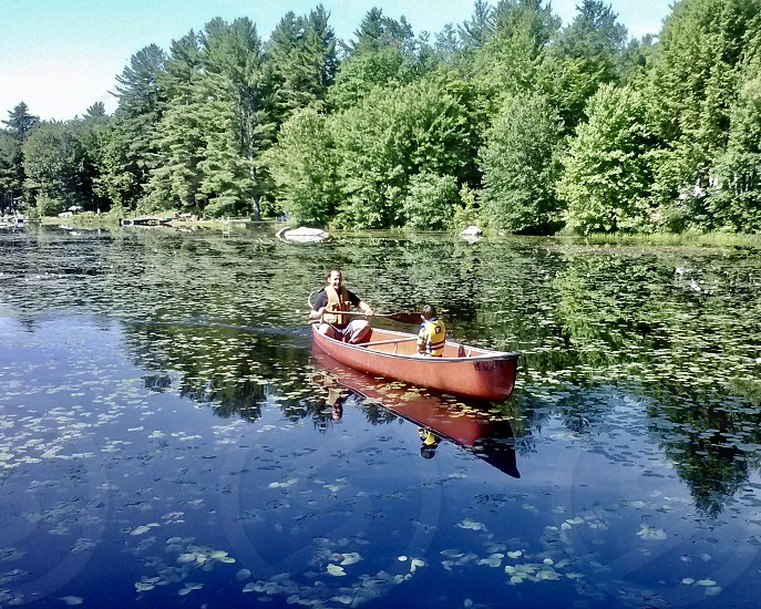 Boating fishing lake family fun outdoors activities lifestyle  photo