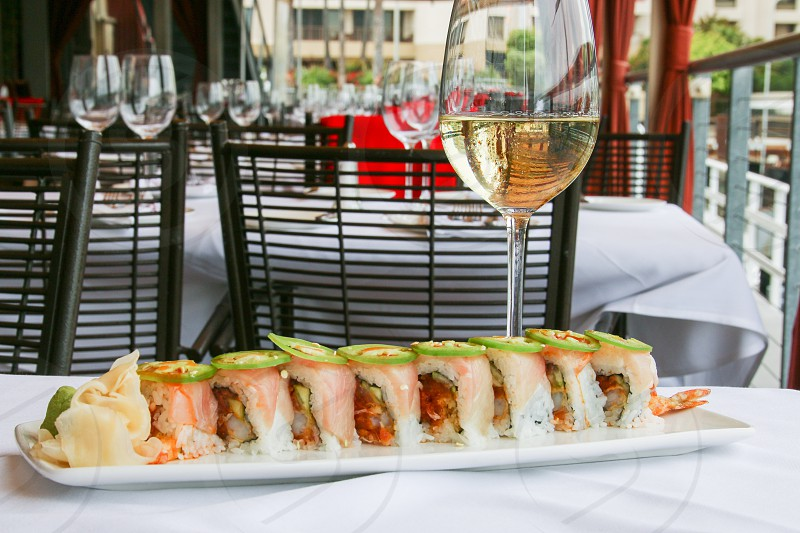 Sushi roll white wine and dining room photo