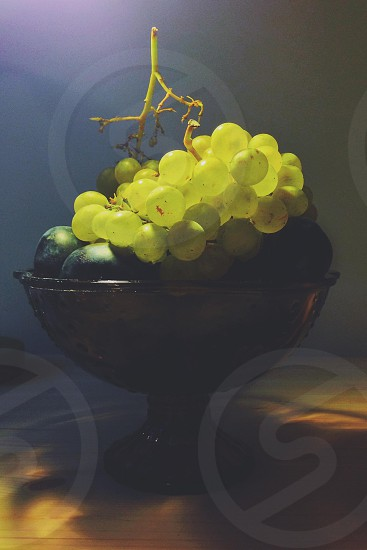 green grapes on brown glass bowl photo