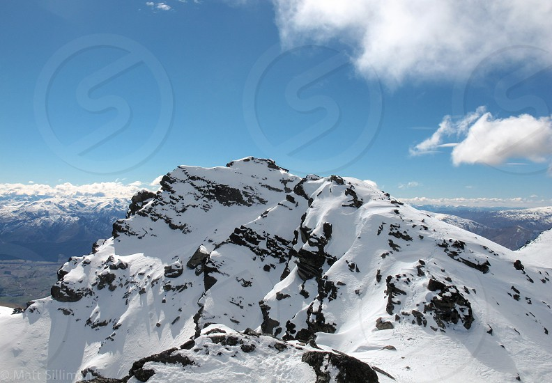 Snow mountains alpine alps mountain blue sky tranquil adventure snowy landscape natural pristine lovely beautiful zen peaceful high altitude mountaineer mountaineering explore push summit ski snowboard adventure sports elevation climb conquer overcome fear doubt outdoors fresh outside hemisphere New Zealand photo