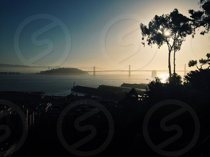 San Francisco bridge and city silhouette from sunrise photo