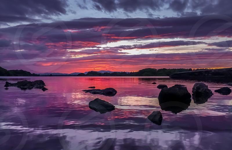 lake reflection ireland sunset photo
