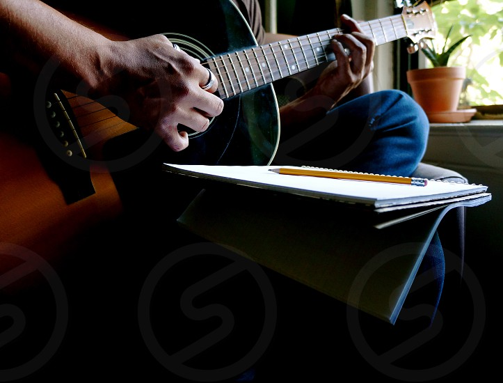 person playing guitar photo