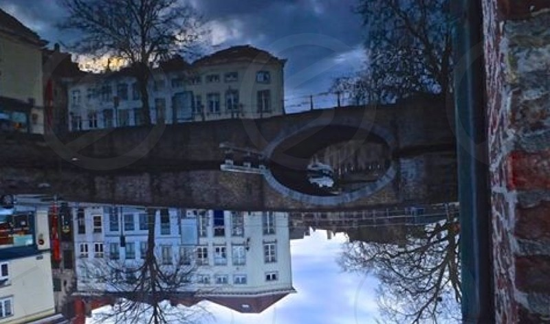 Which way is up? Mirror reflection Brussels Belgium Bruges  photo