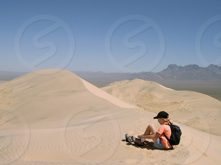 Climbing to the top of a sand dune Kelso Sand Dunes Mojave photo