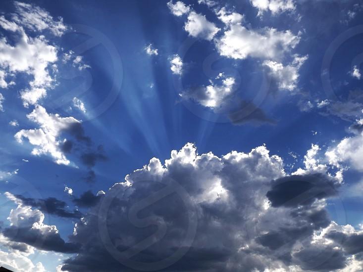 blue sky clouds sun ray photo
