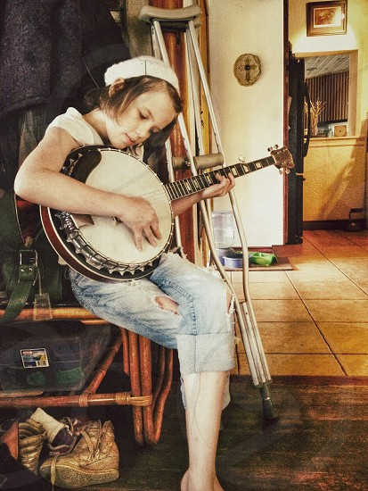 Young girl playing music in times of distress photo
