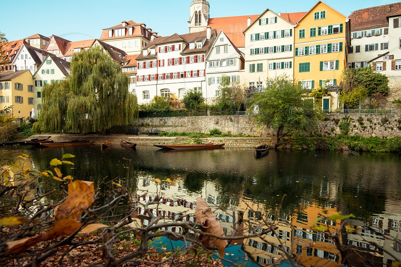 Germany Tubingen city in Autumn view from park on the river and historic buildings photo
