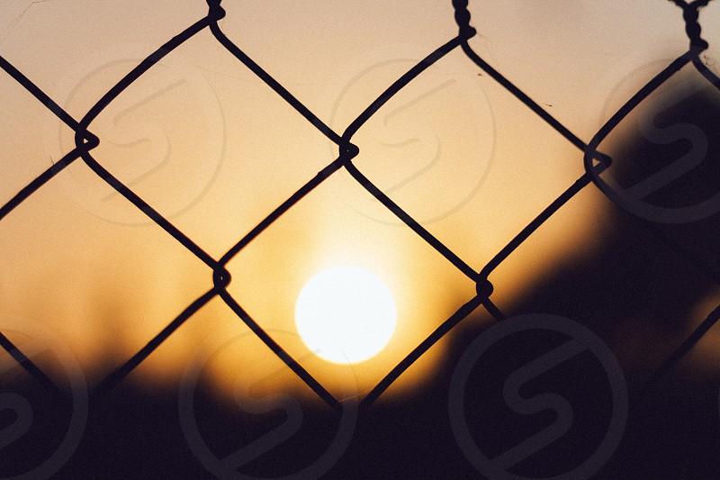 Capturing the Sunset through the fences at Biola University photo