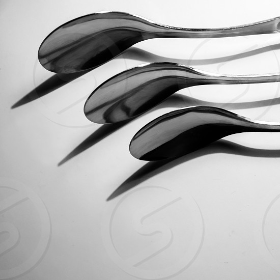 grayscale photography of 3 stainless steel spoon photo