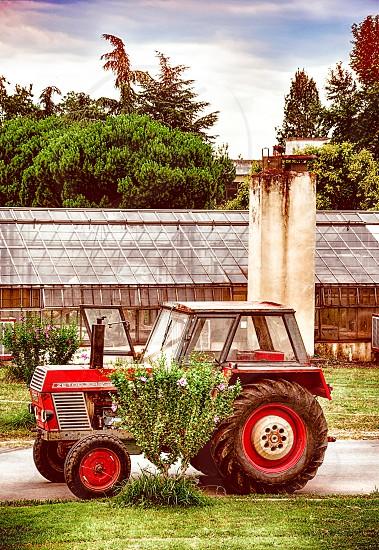 Farm Tractor In Rural Landscape photo