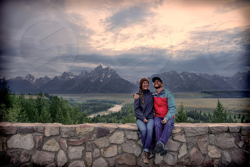Smiles under the Tetons. Happy and laughing on the road trip across America. photo