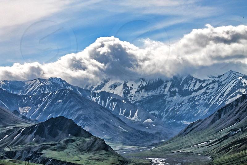 Landscape view of cloud covered Mount Denali in Alaska photo