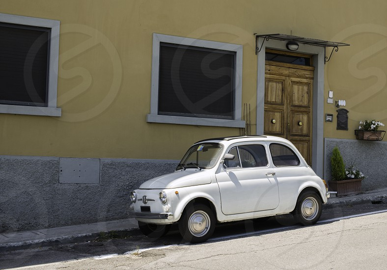 White small vintage Fiat Abarth. Sin light photo