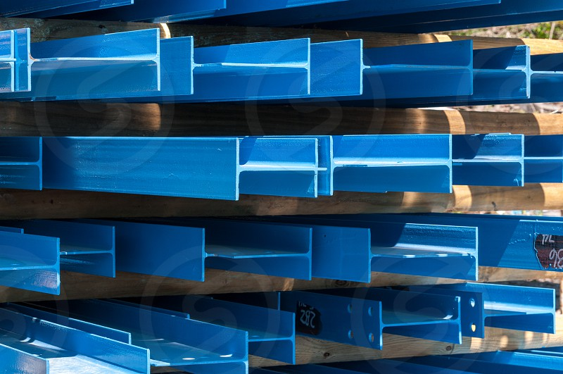 Stacked steel beams ready to ship photo
