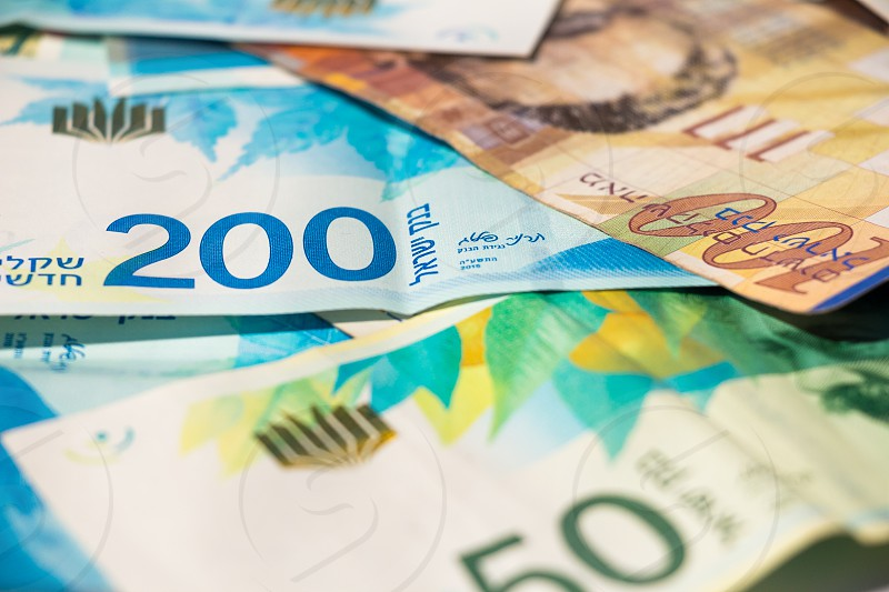 Stack of various of israeli shekel money bills. photo