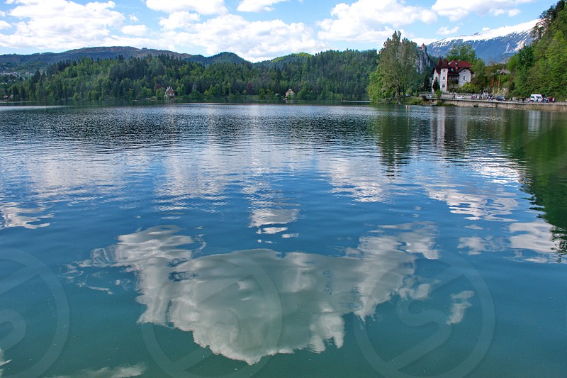 Clouds reflected in the Bled lake in Slovenia photo